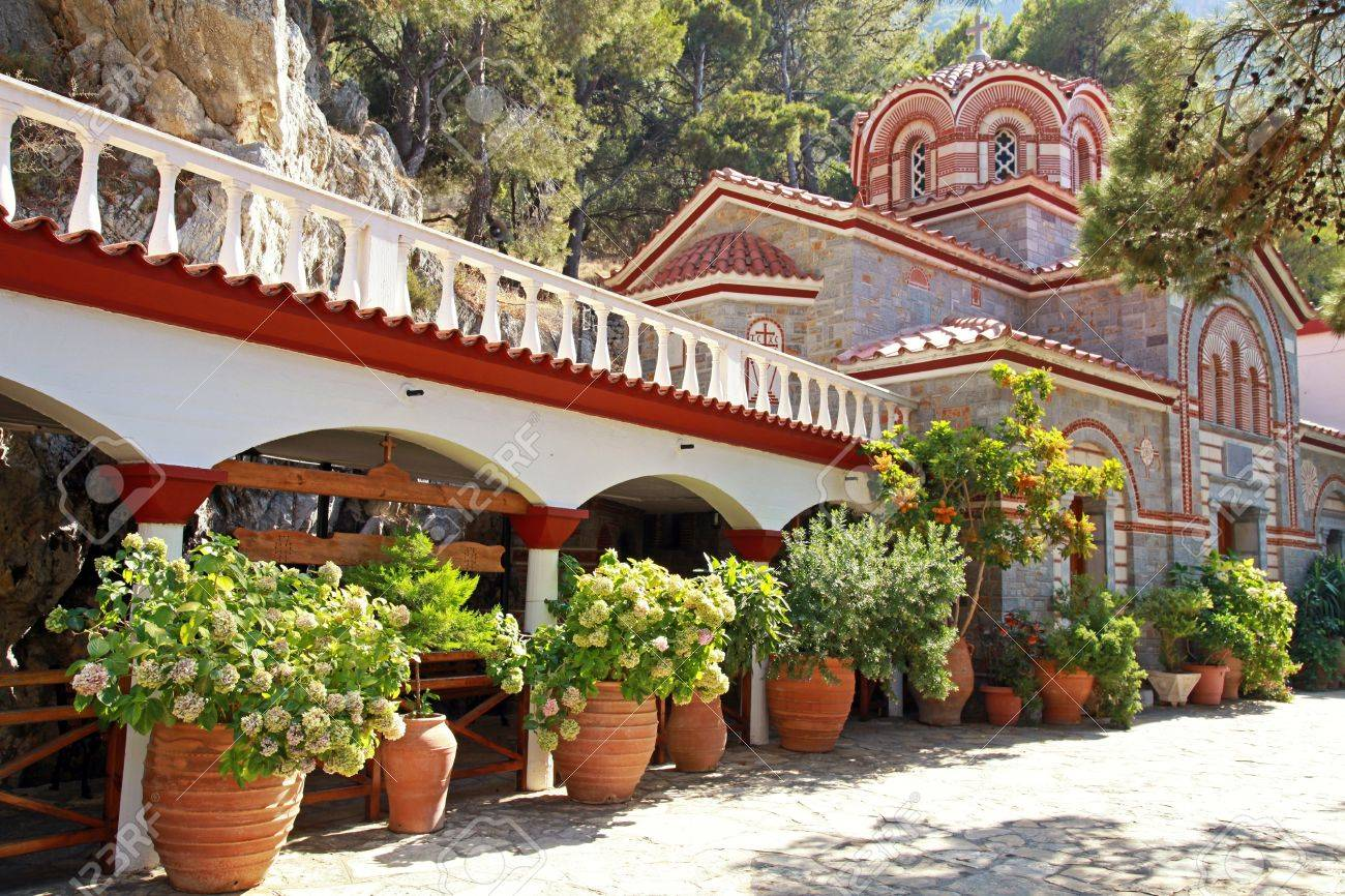 Beautiful Garden With Patio And Flower Pots In Old Mountain Orthodox  Monastery(Crete, Greece