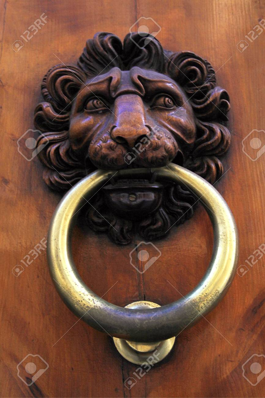 antique door knob with lionu0027s head on old wooden obsolete door florence italy stock