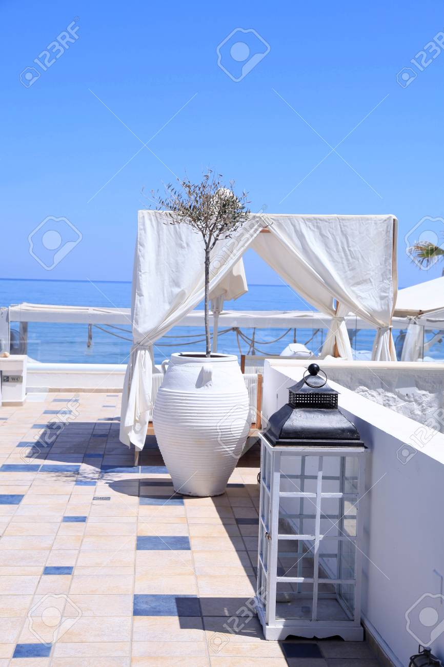 Romantic Terrace Patio Of Seaside Resort With Outdoor Furniture, Flower  Bawl And Sea View,