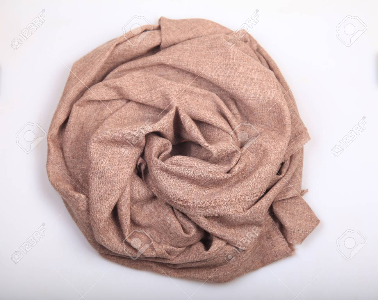 f61efa160 Light brown linen and cashmere scarf on white background, scarf top view .  Stock Photo