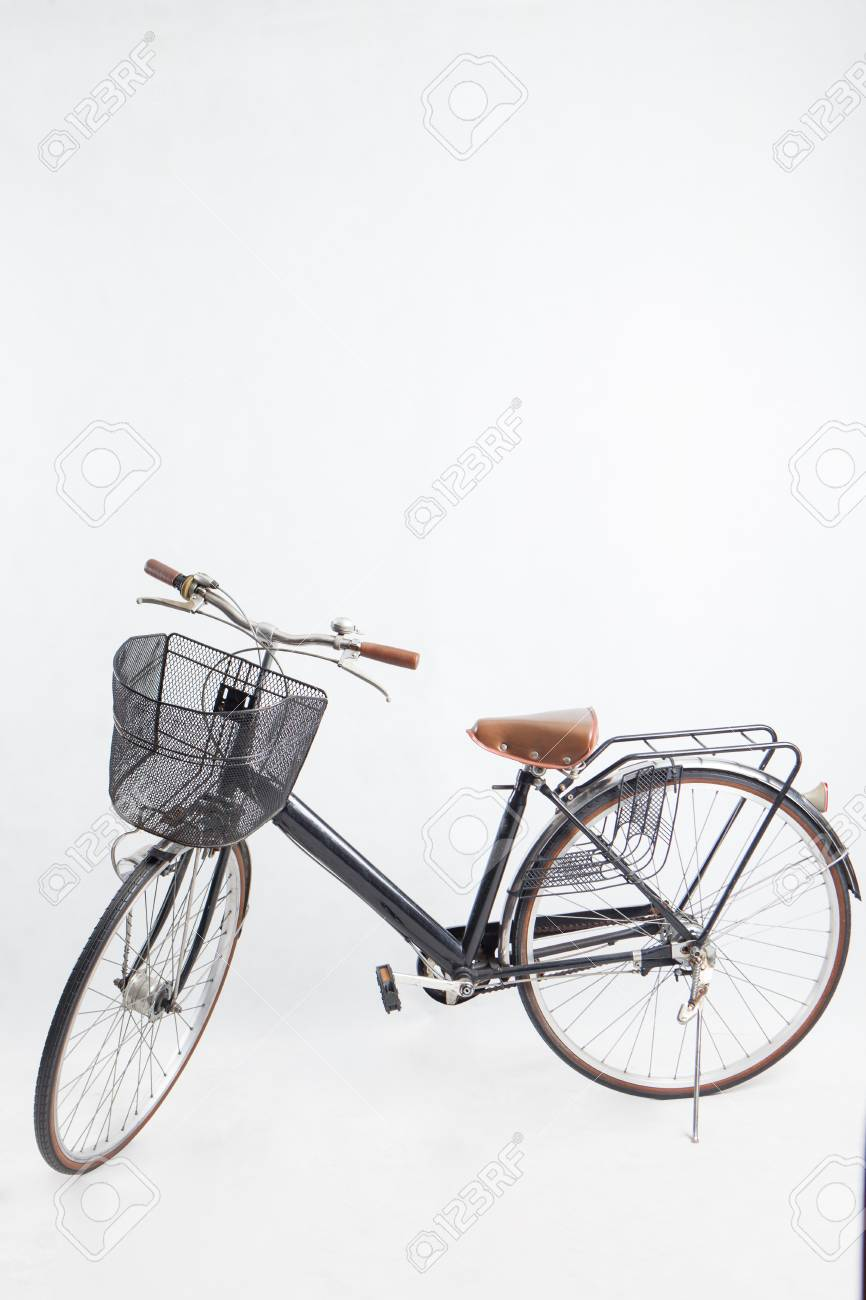8f718b6478c Old black bike Retro .vintage bike a basket of front.White backdrop Stock  Photo