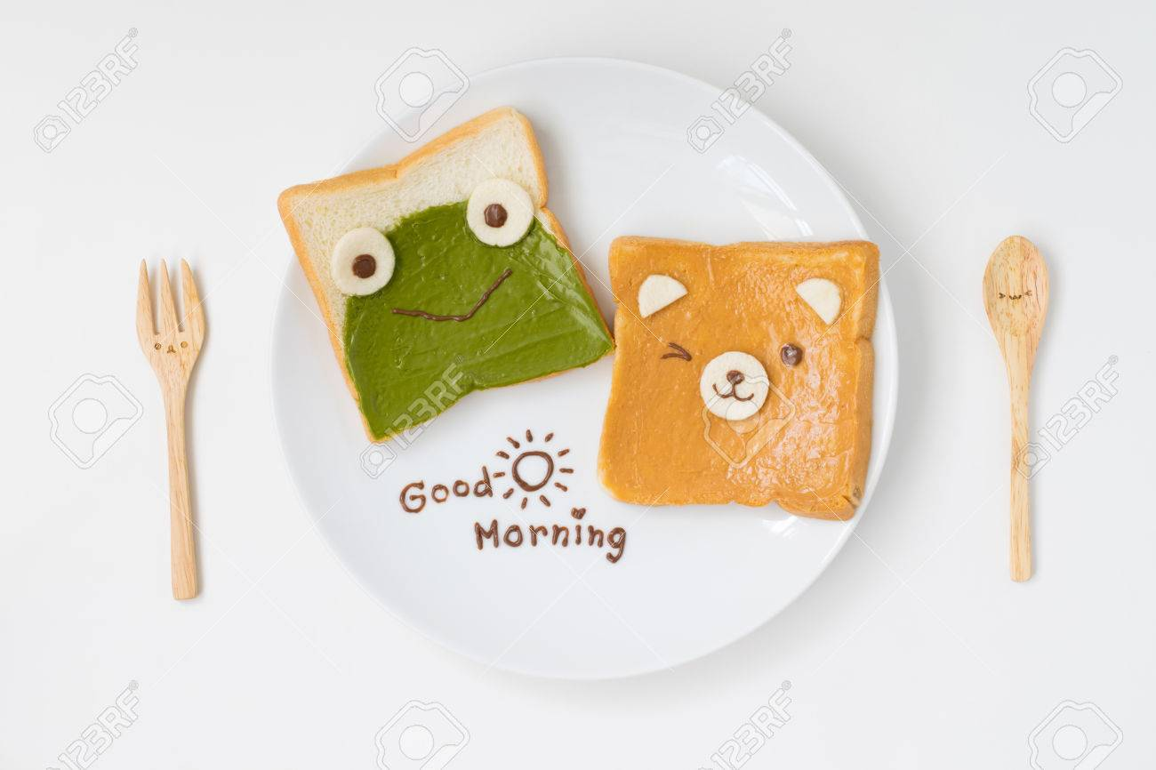 Top View Of Cute Breakfast For Kids, Green Tea Spread And Peanut Butter  Design To Frog And Bear On Breads With Good Morning Text With Cute Spoon  And Fork On ...