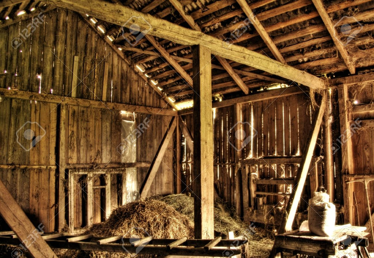Interior Of Abandoned Old Barn At Lithuanian Countryside Stock Photo