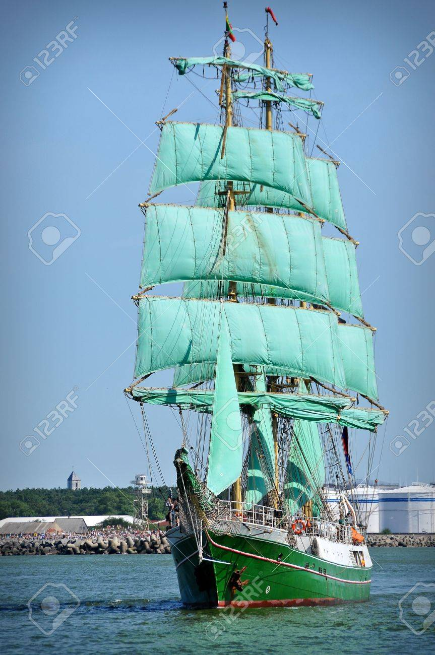 sailboat going out of port with full sails up Stock Photo - 5599237