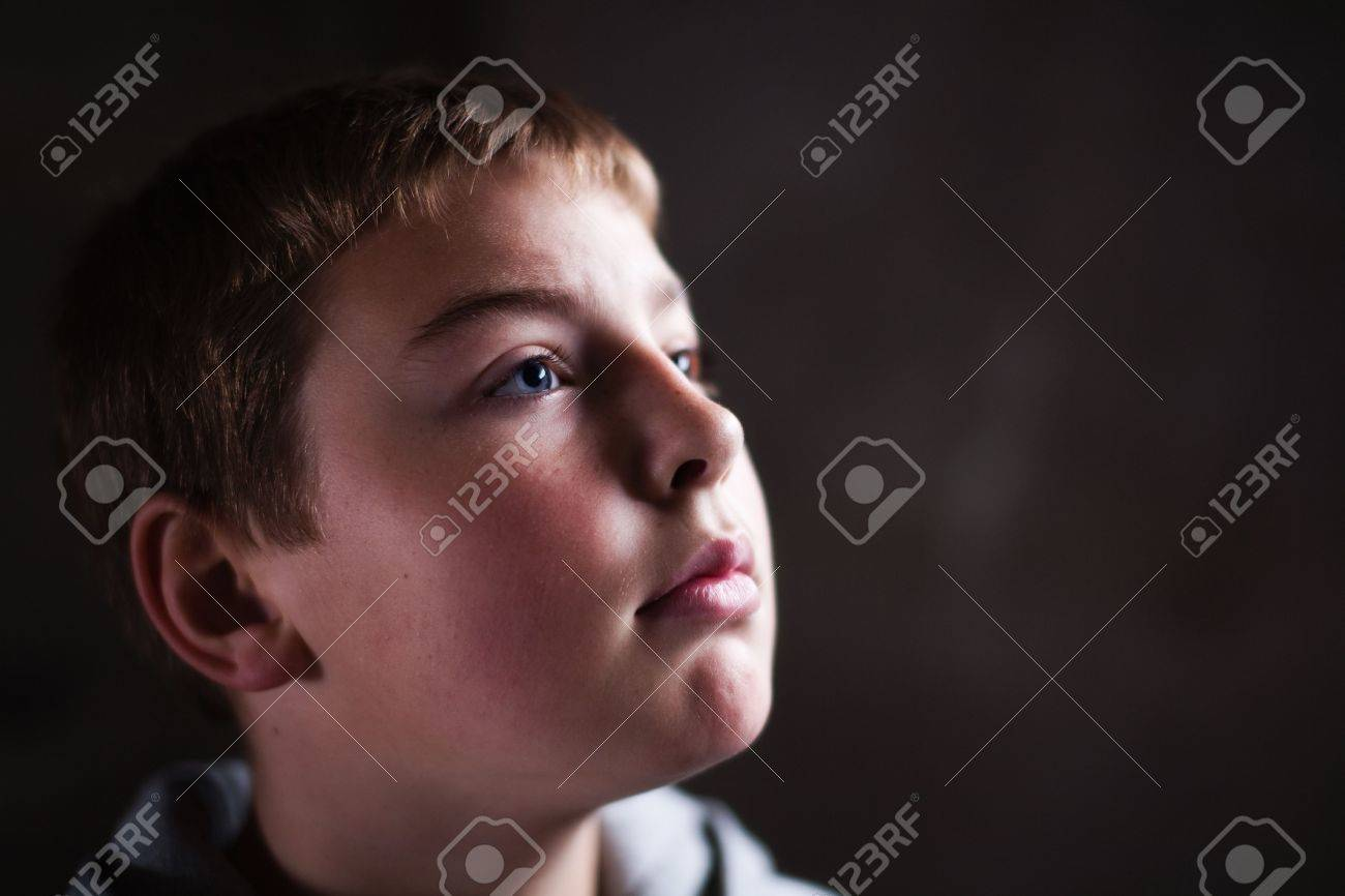 Young boy looking up with hope in his eyes against grunge background flash lit 3 light sources Stock Photo - 5979089