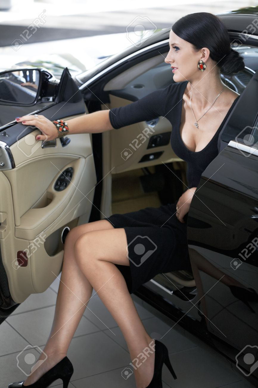 Sexy woman in luxury car with long legs Stock Photo - 16729254