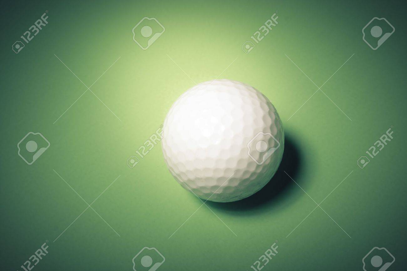Golf ball over a green background Stock Photo - 12359960