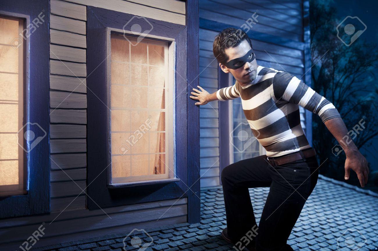 dangerous burglar about to enter house Stock Photo - 12359978
