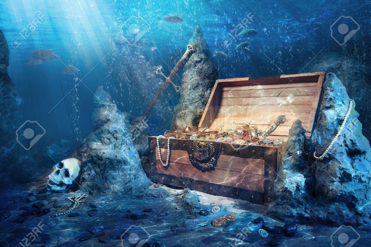 photo of open treasure chest with shinny gold underwater stock photo