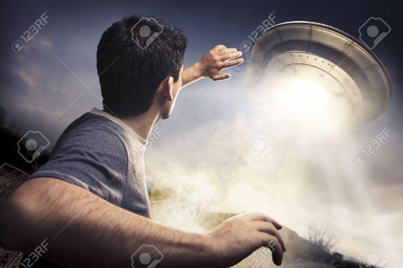 man running away from a UFO - 13086212