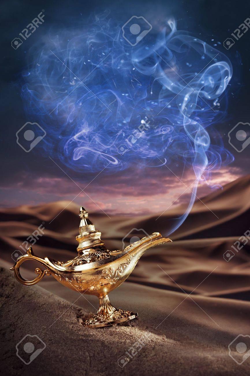 Aladdin magic lamp on a desert with smoke Stock Photo - 15528024