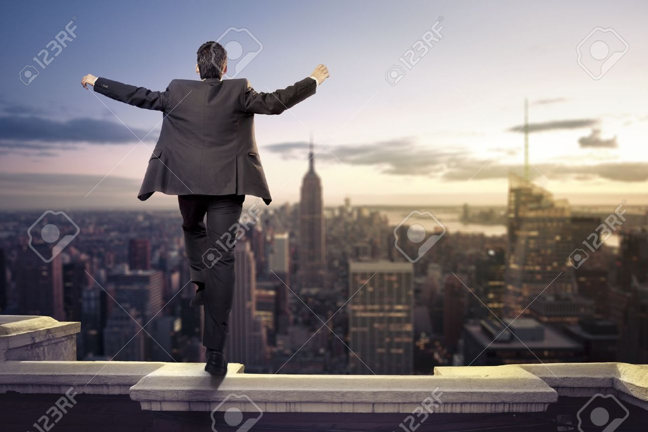 Troubled businessman jumping from the top of a building Stock Photo - 15384704