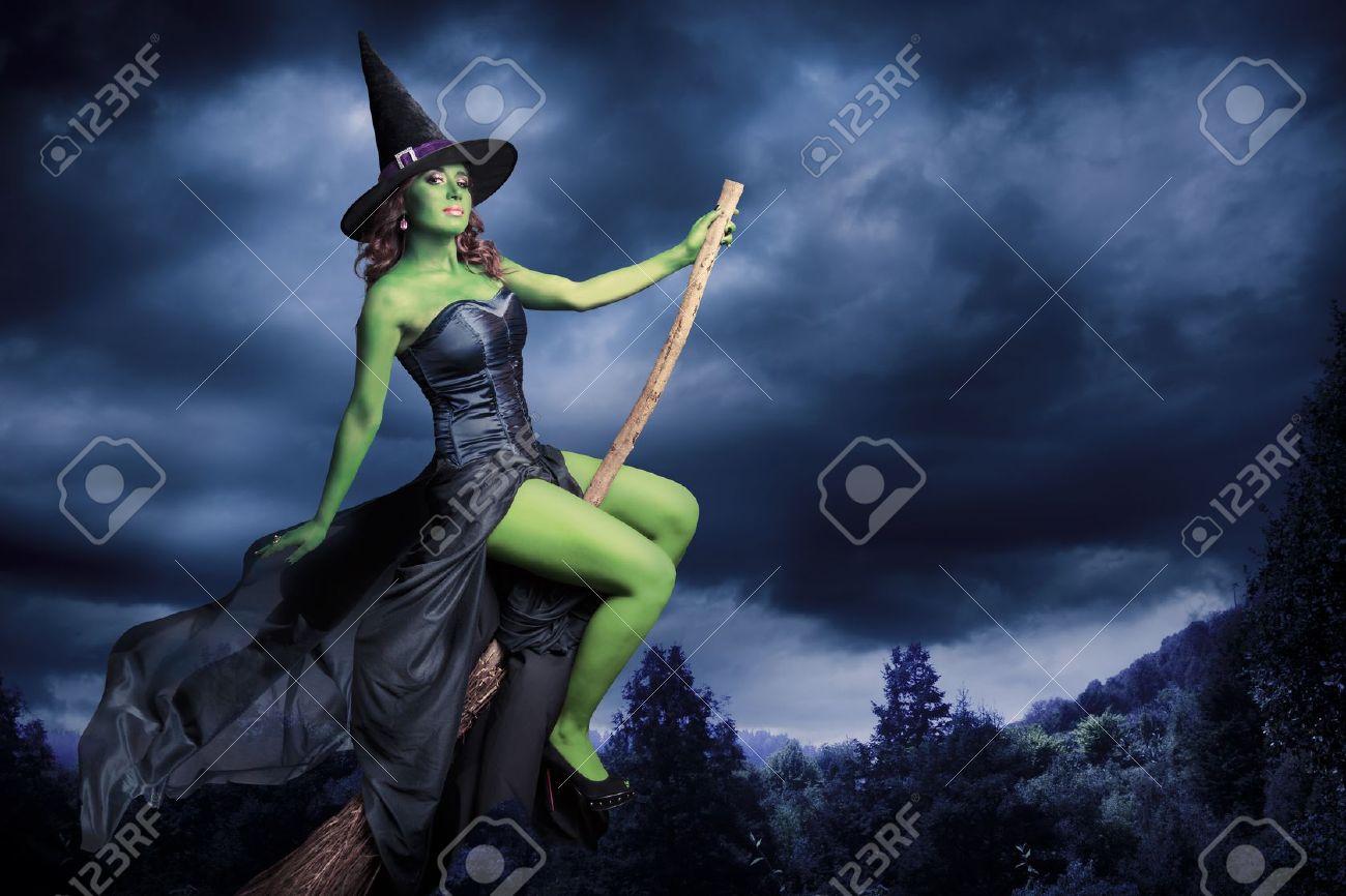 Sexy witch on a dark background Stock Photo - 15561960
