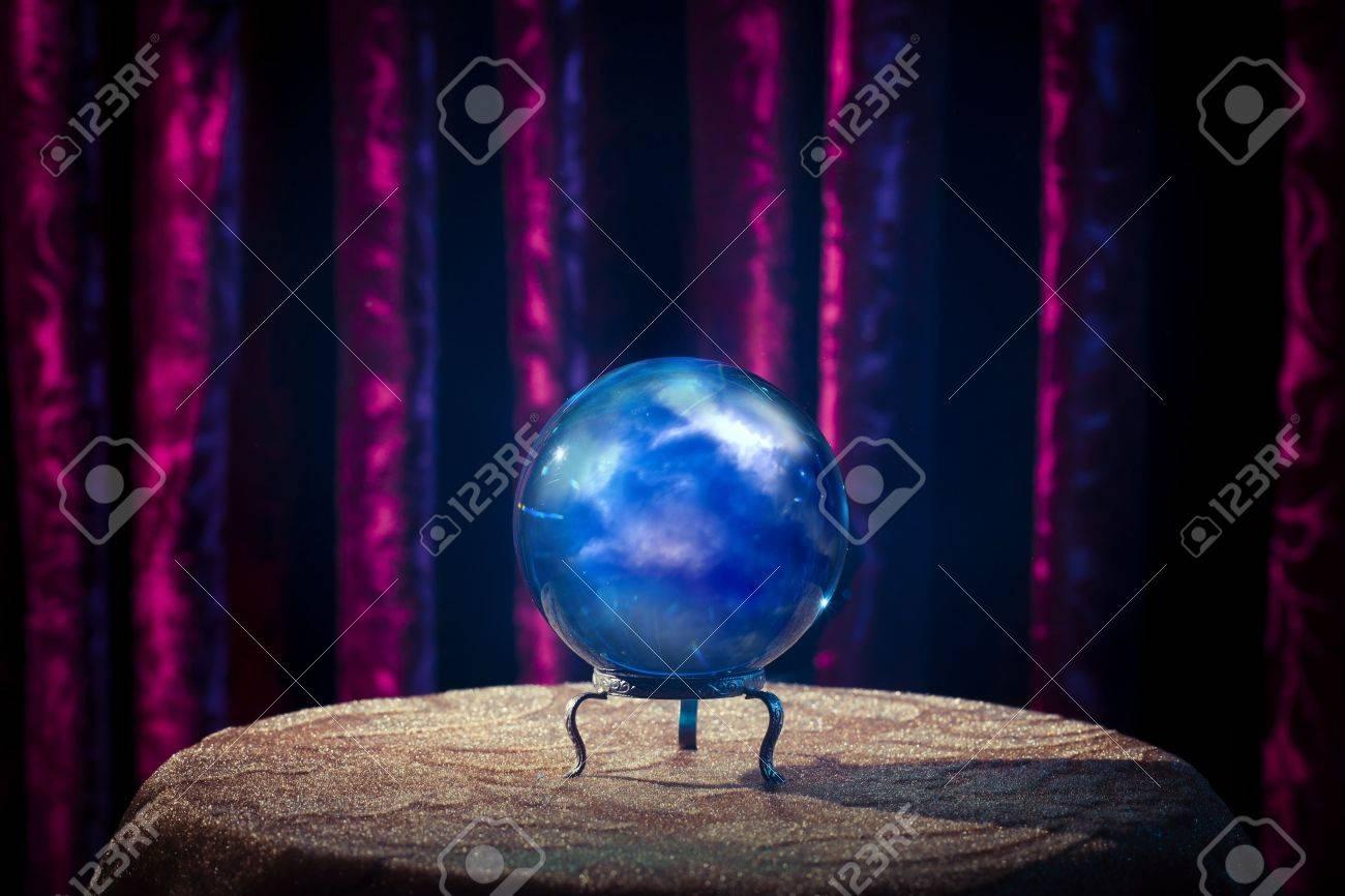 Magic crystal ball on a table Stock Photo - 28028764