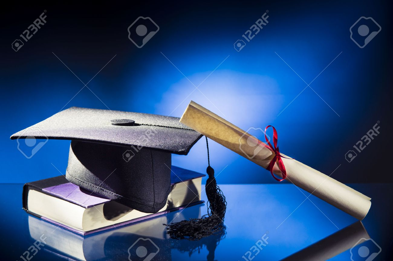 Free coloring pages graduation caps - Graduation Cap Diploma Graduation Hat And Book On A Blue Background