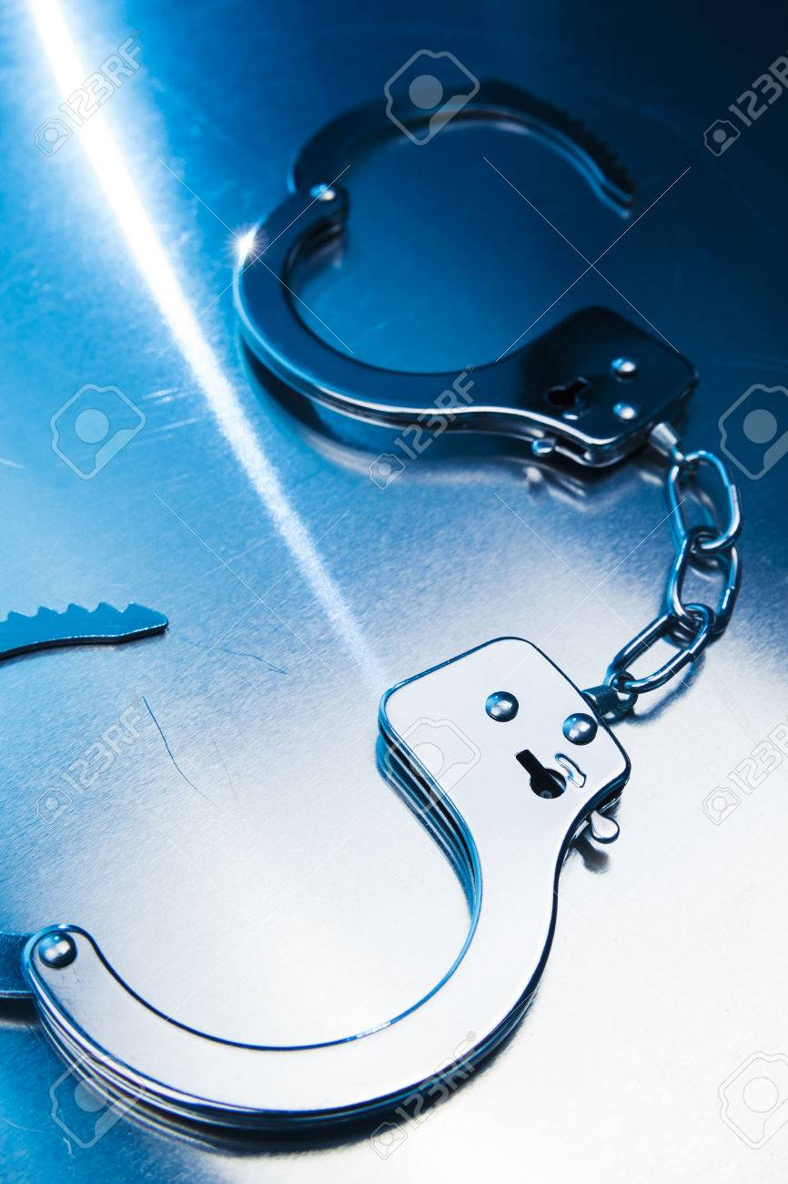 Open handcuffs, liberty concept on a metallic background Stock Photo - 28046678