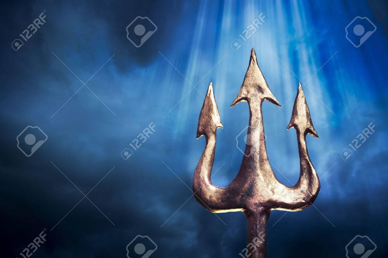 Poseidons trident on a dark sky background stock photo picture and poseidons trident on a dark sky background stock photo 28047424 biocorpaavc Choice Image