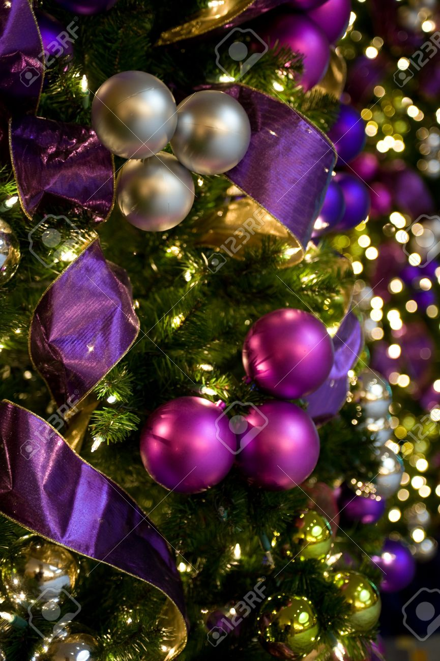 Purple and gold christmas tree decorations - Beautiful Purple And Gold Christmas Ornaments And Lights Stock Photo 4298153
