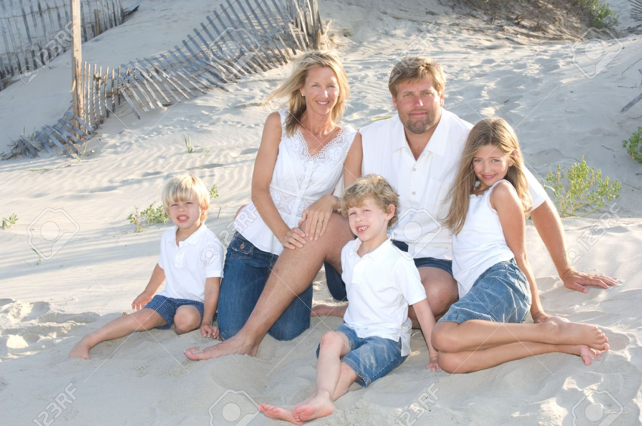 family of five smiling at the beach stock photo, picture and royalty