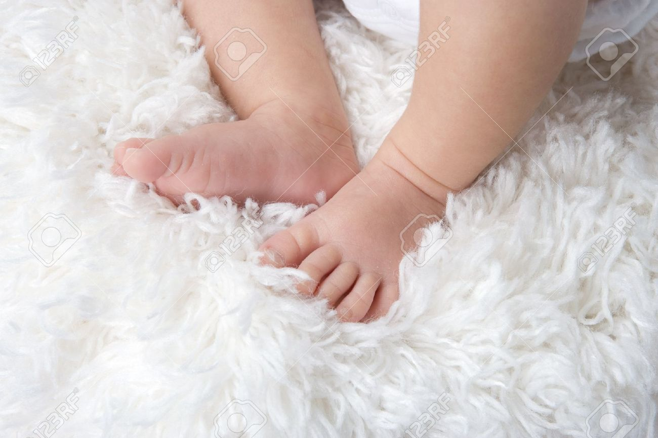 Baby Feet On A White Carpet Stock Photo Picture And Royalty Free