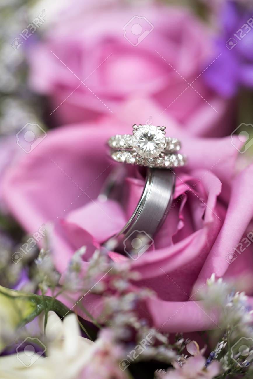 Beautiful Wedding Rings In Lavender Rose Bouquet Stock Photo ...