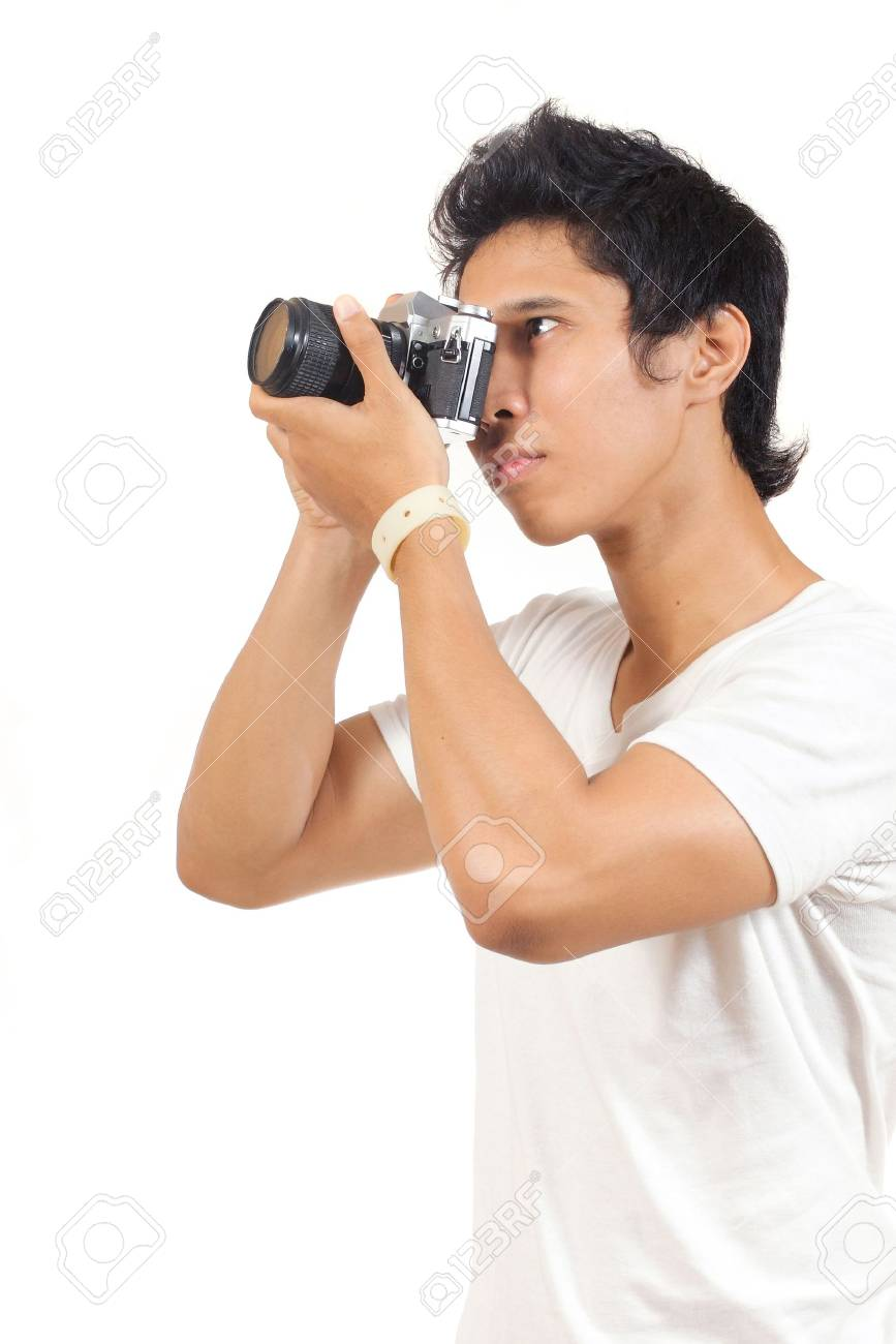 photographer shooting something with his camera Stock Photo - 13528291