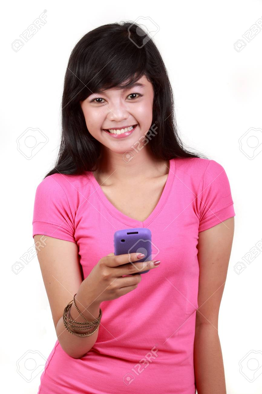 Mobile phone in woman hand smiling isolated on white background Stock Photo - 10338877