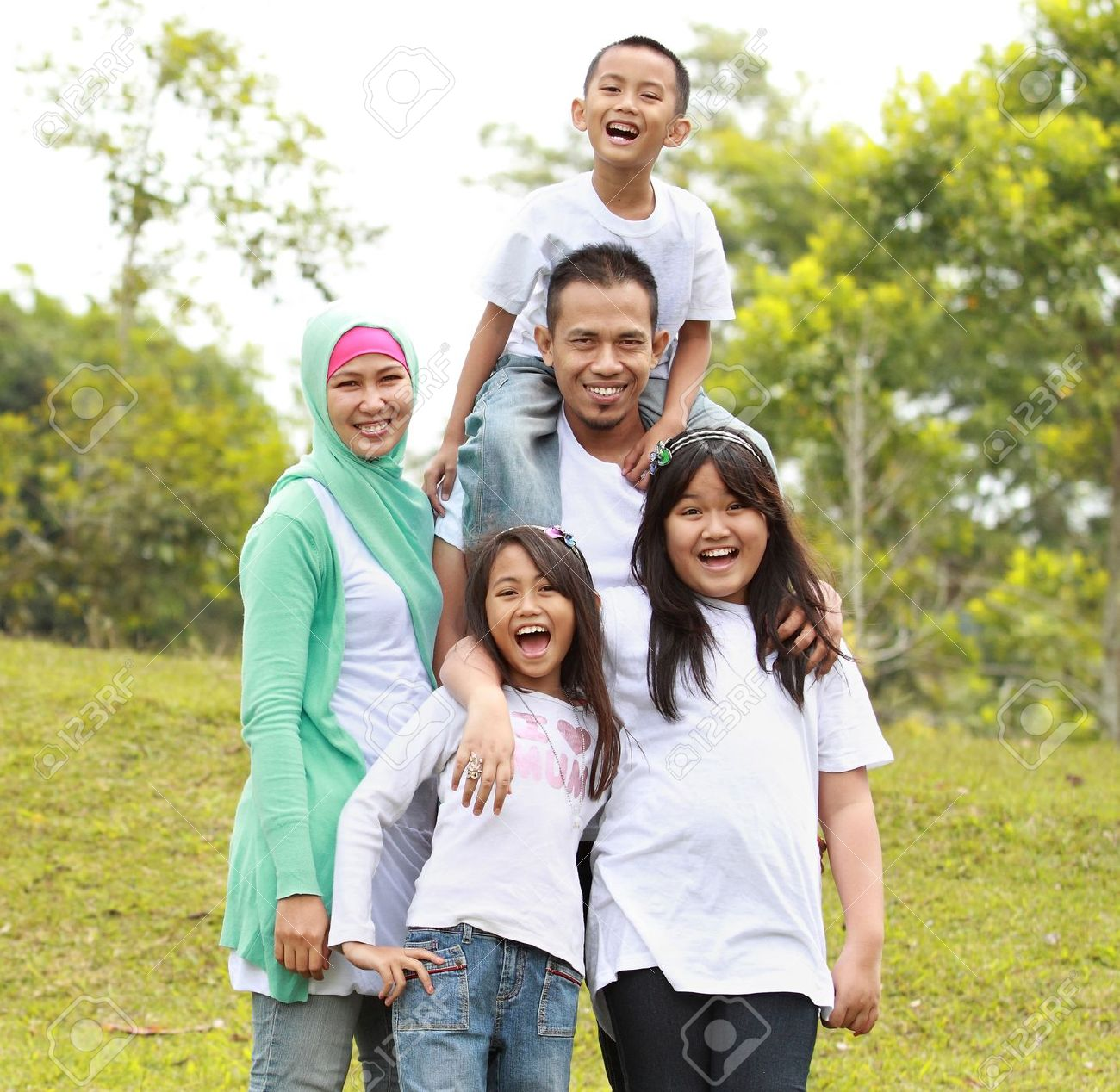 Portrait of Happy Family In Park Stock Photo - 10409882