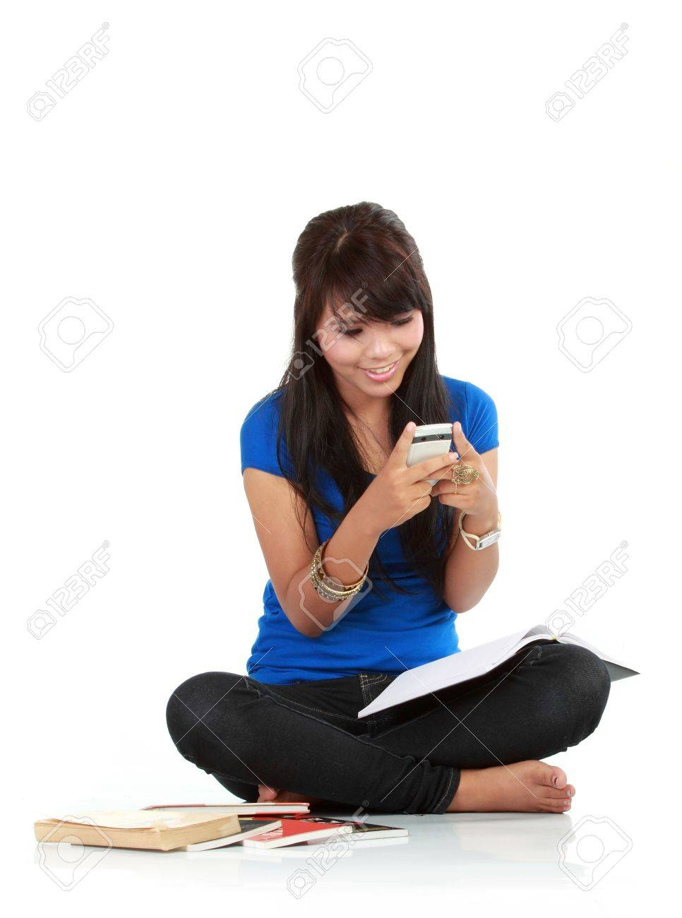 Cute Girl Holding handphone with isolated bacground Stock Photo - 10761828