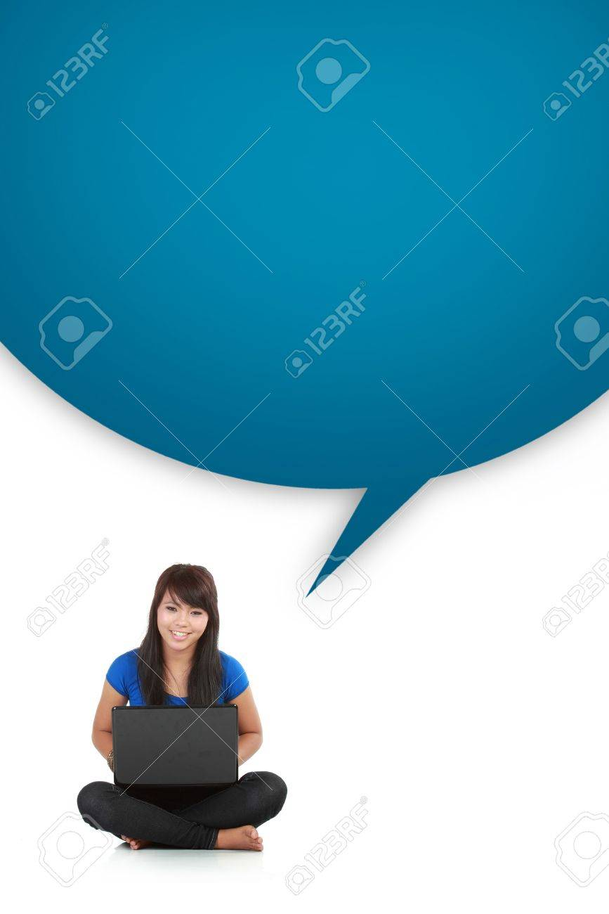 young casual woman sitting down smiling holding laptop with box word isolated background Stock Photo - 10761822