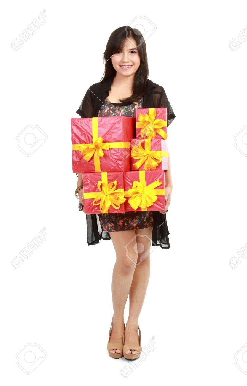 Beautiful girl taking stack of gift box. Isolated. Stock Photo - 11315429