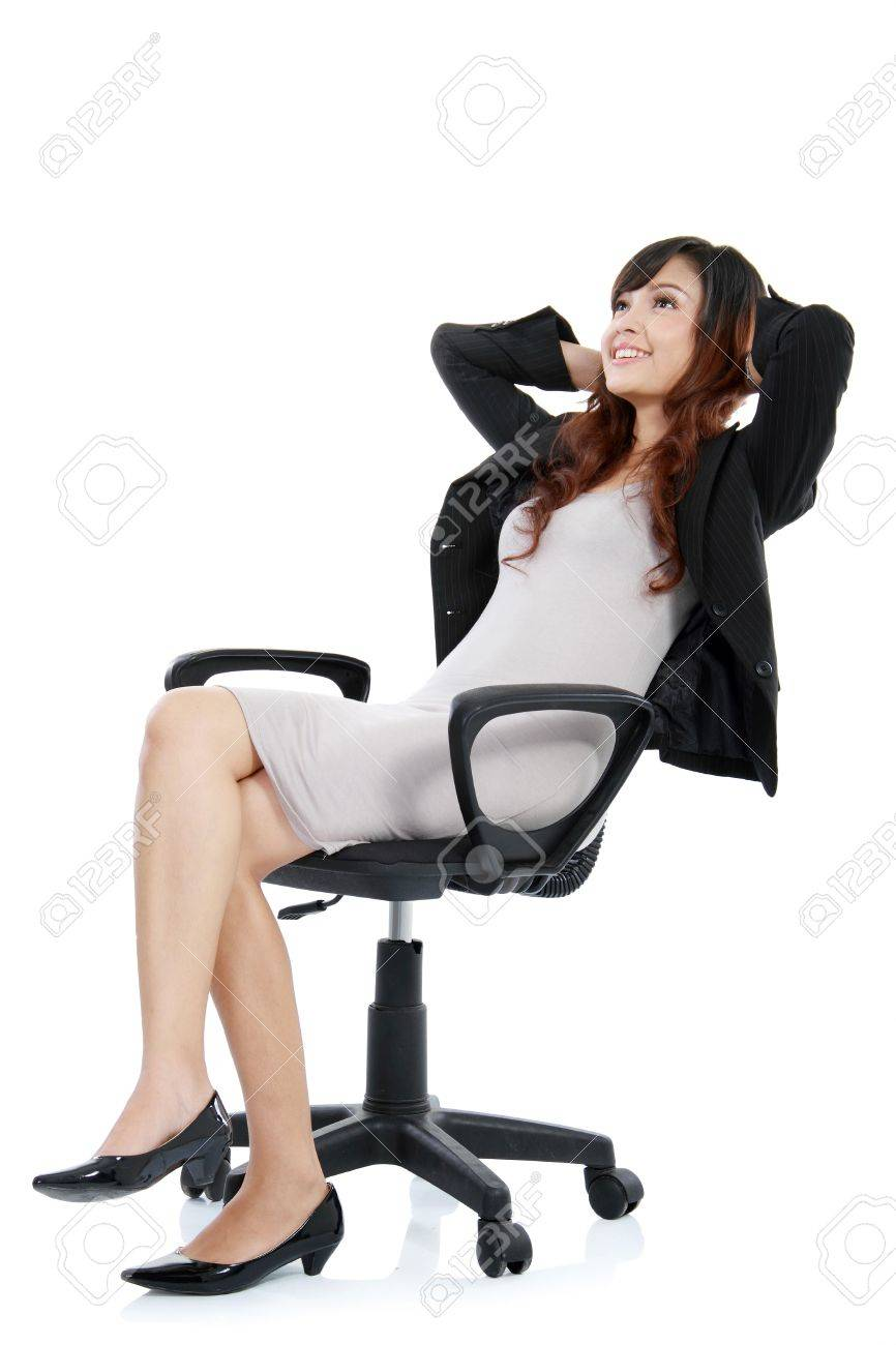 happy excited young businesswoman, relaxing in office chair, isolated on white Stock Photo - 11844702