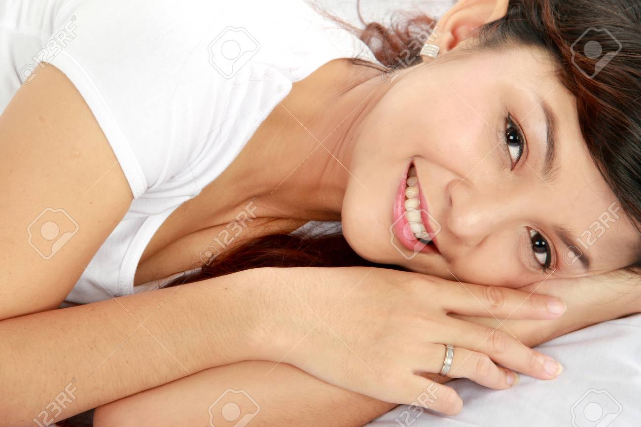 lovely young female lying on the bed looking at camera Stock Photo - 11846276