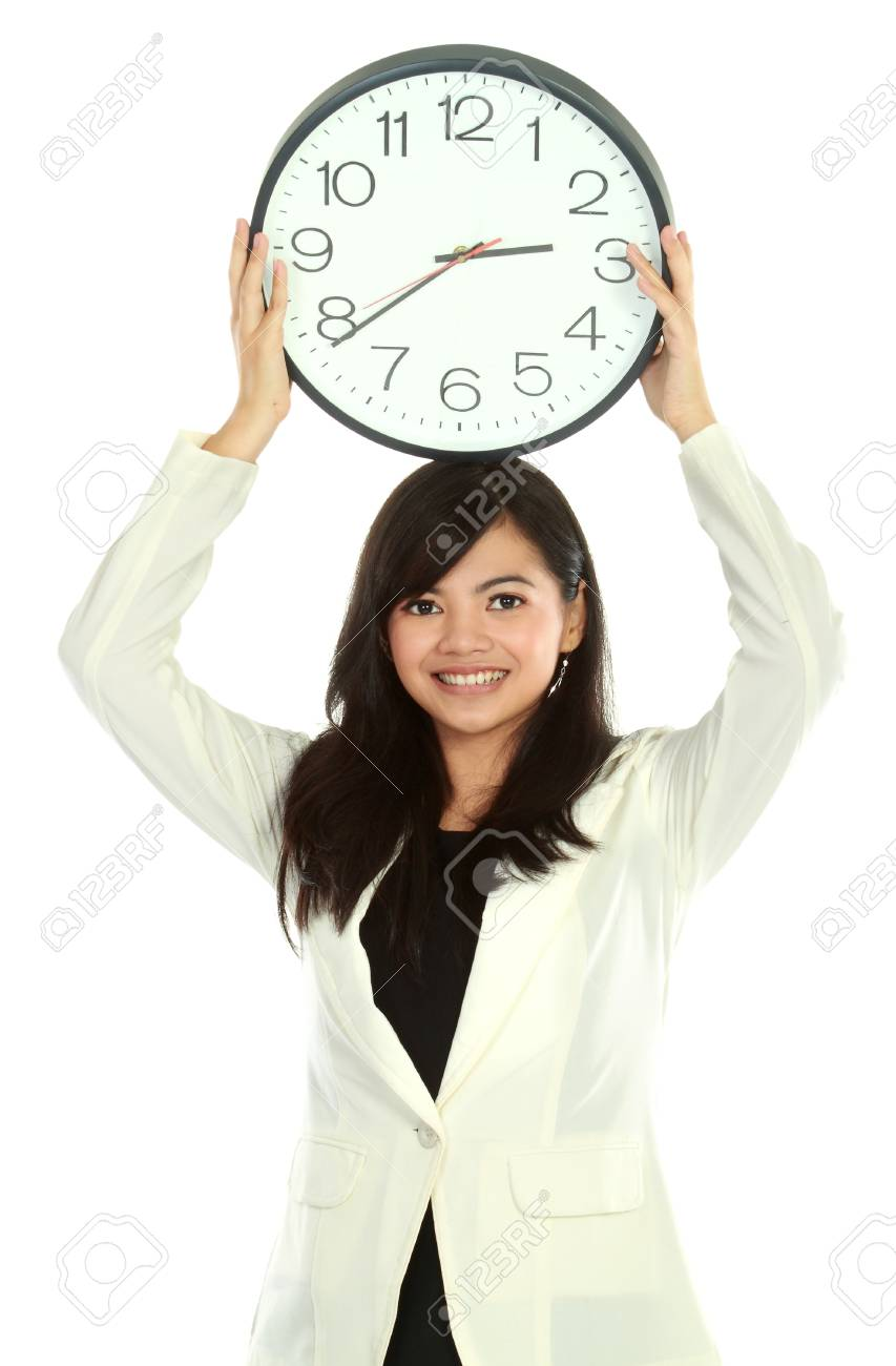 young business woman smiling holding a big clock Stock Photo - 12004773