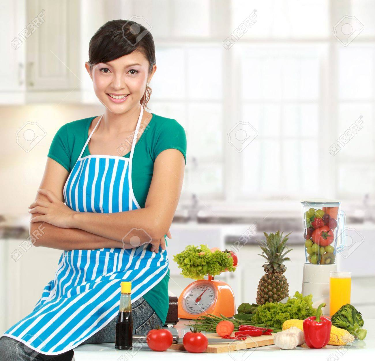 Beautiful woman preparing ingredient  on the table to cook something Stock Photo - 12371474