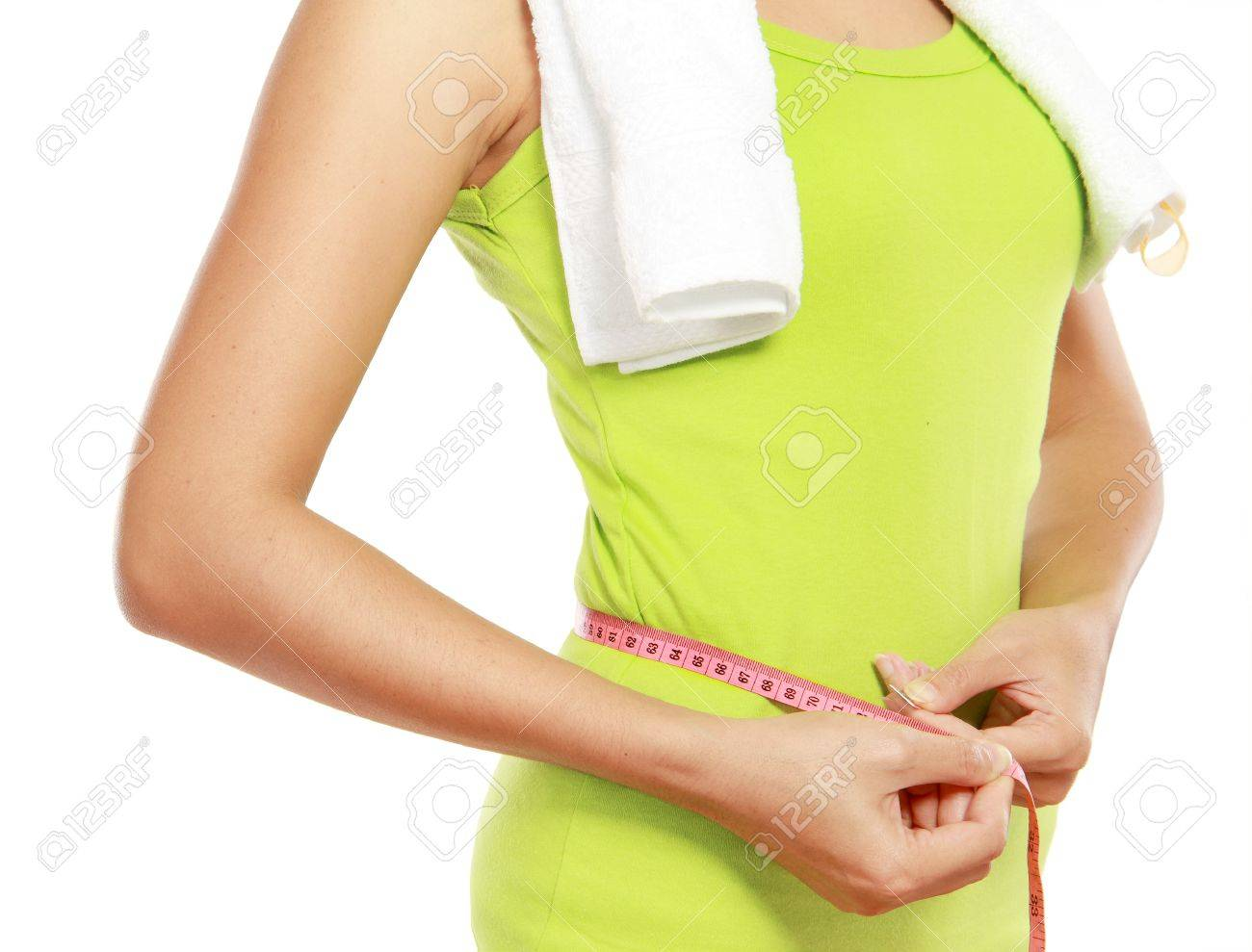 close up of slim female body with measure tape around her body - 12371641