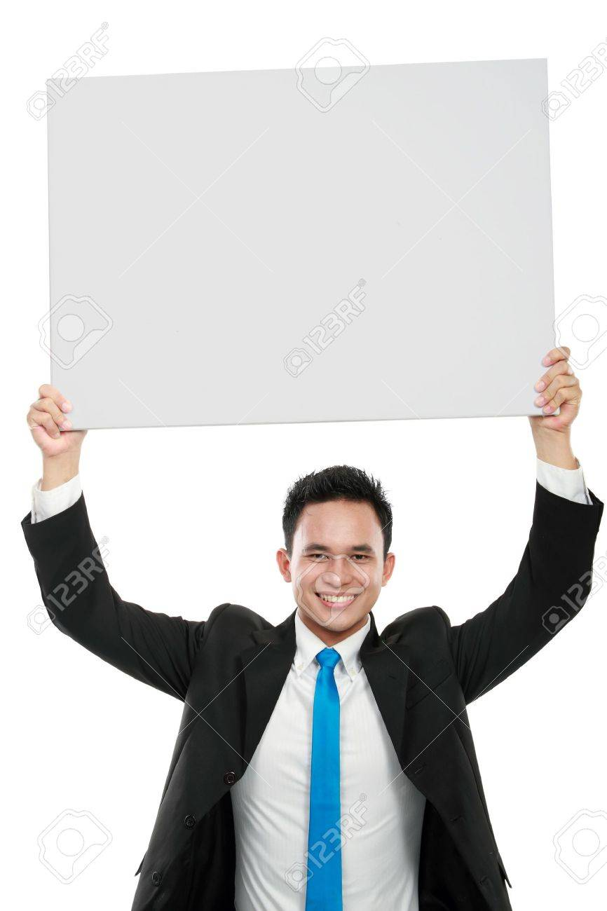 Portrait of a smiling young business man holding a blank billboard on top of his head Stock Photo - 12809612