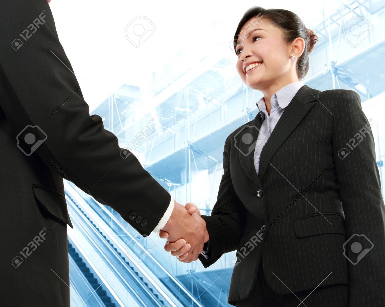 Hand shake between a businessman and a businesswoman in office environment Stock Photo - 13409168
