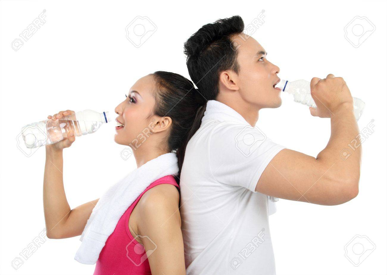 Portrait of sporty healthy young woman and man drinking water isolated on white background Stock Photo - 13409121