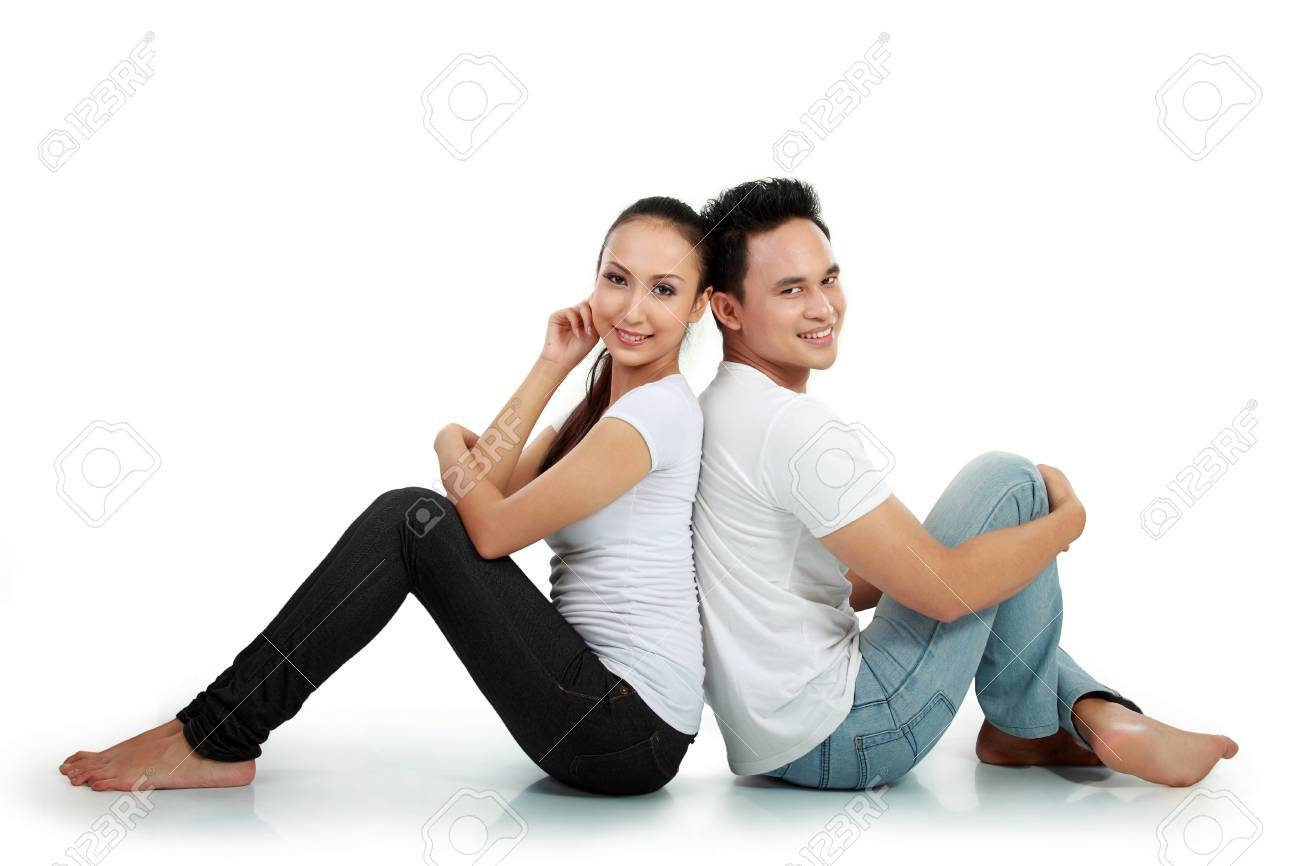 portrait of asian happy couple smiling while sitting on white background Stock Photo - 13497076