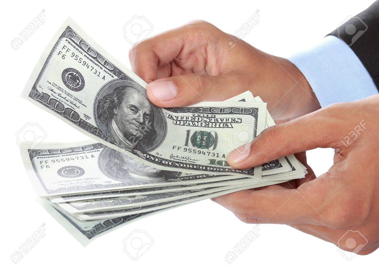 Hand with money isolated on white background Stock Photo - 14314662