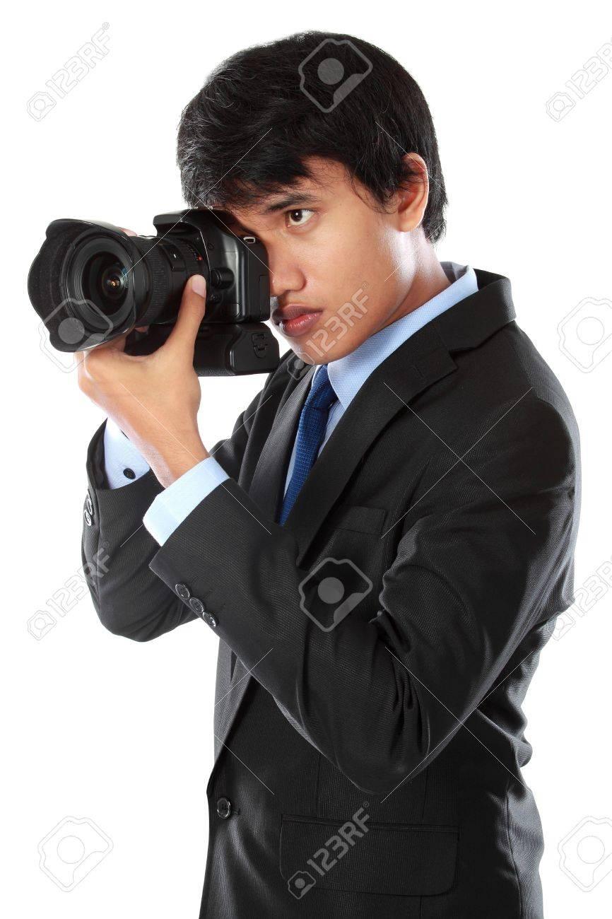 portrait of professional photographer ready to take photo using dslr camera Stock Photo - 14373813
