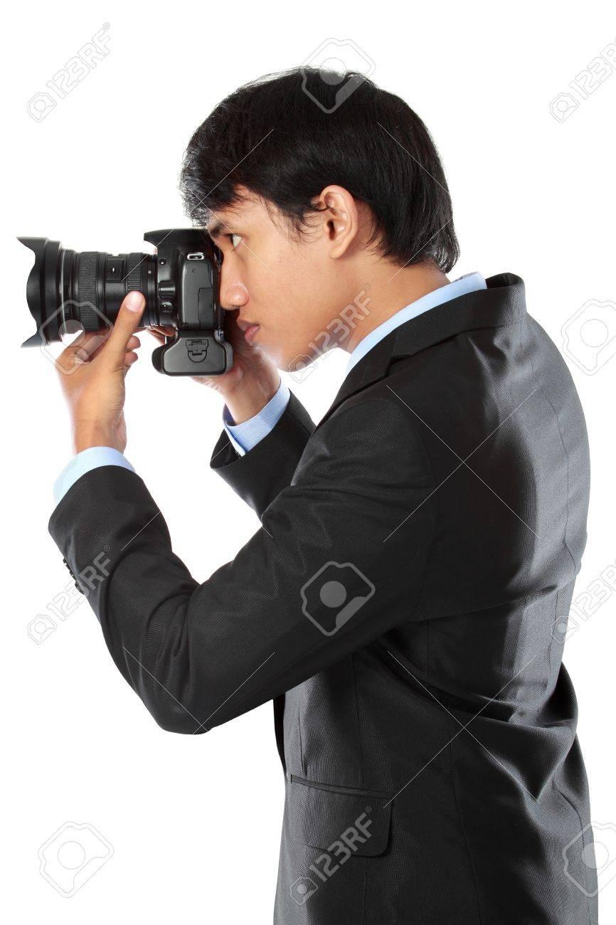 portrait of professional photographer ready to take photo using dslr camera Stock Photo - 14373812
