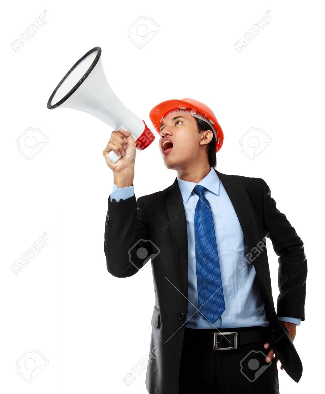 business man shouting using megaphone isolated on white background Stock Photo - 14373790