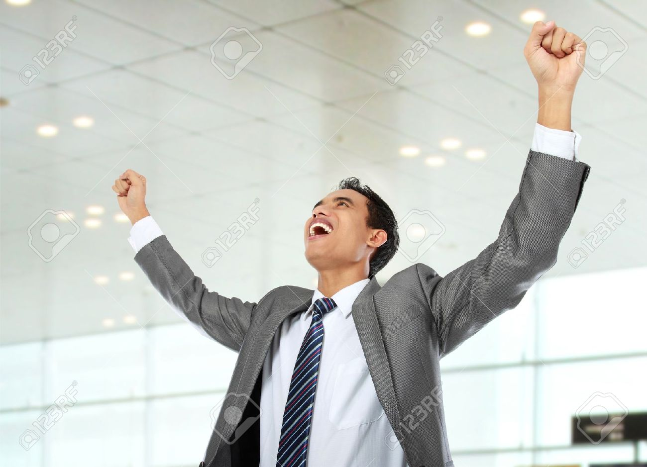 Excited Business Man Celebrating Success In The Office Stock Photo Picture And Royalty Free Image Image 14619474