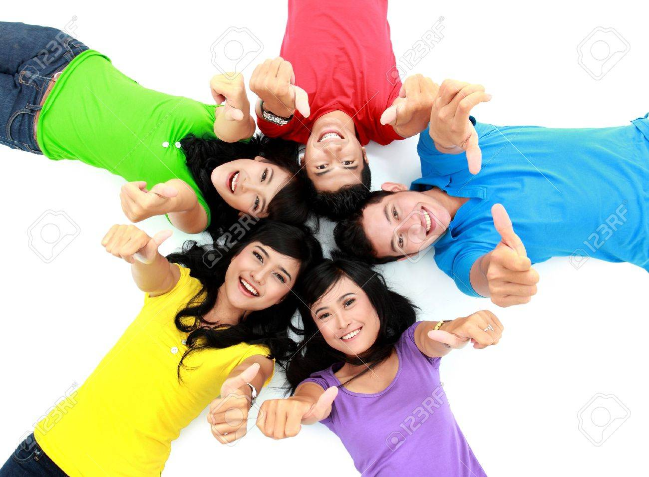 happy group of friends lay down on the floor showing thumb up Stock Photo - 16035489