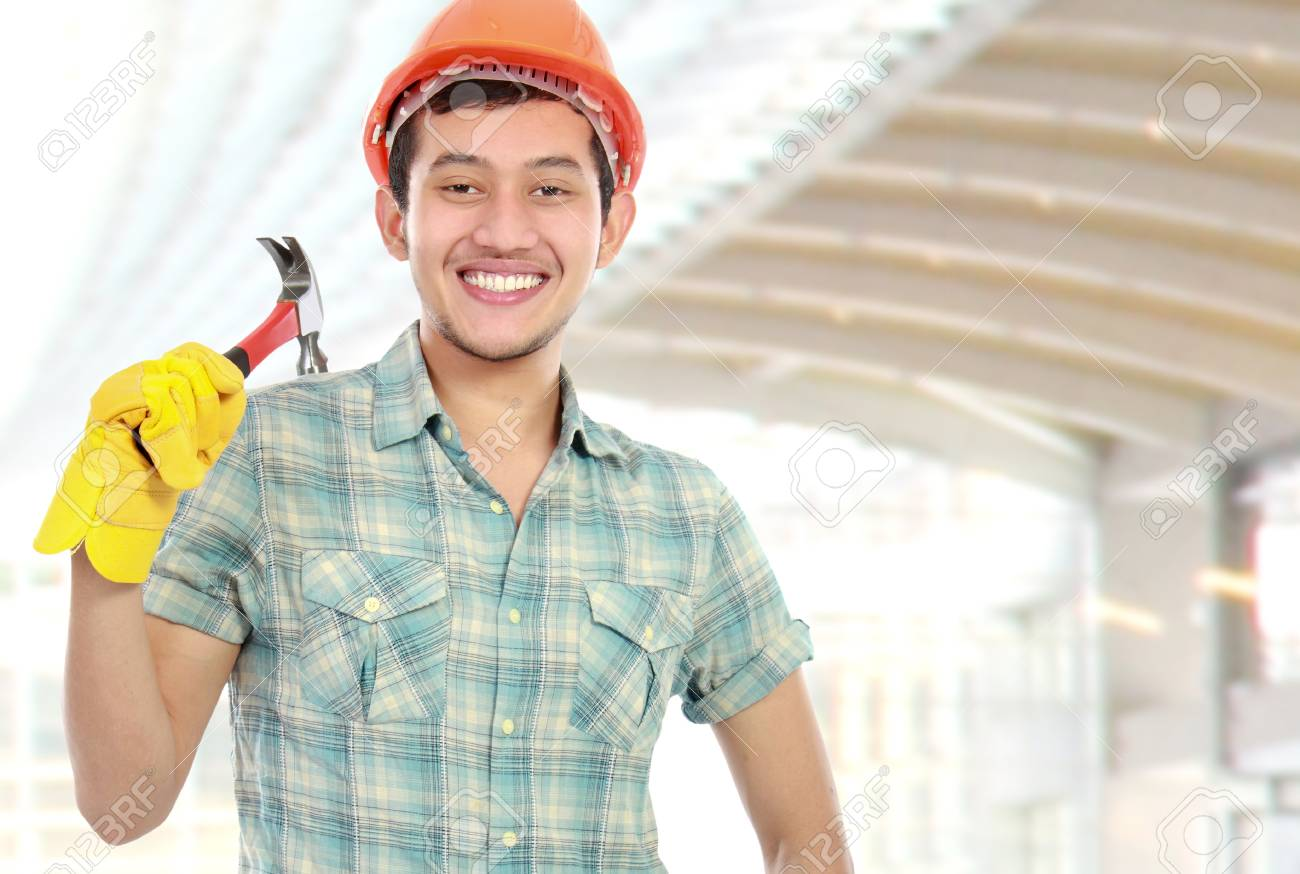 Portrait of an happy worker with hammer at contruction sites Stock Photo - 16116773
