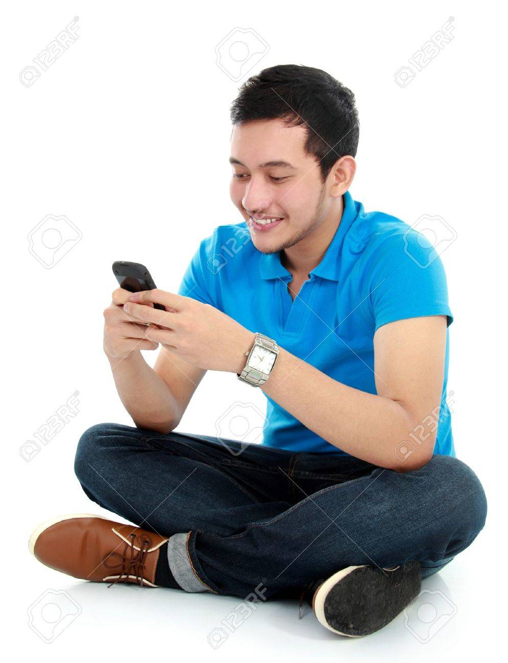young asian man texting message at his mobile phone Stock Photo - 16116772