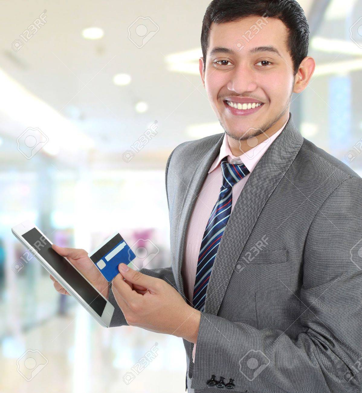 potrait of young business man hold a tab and credit card Stock Photo - 16165607