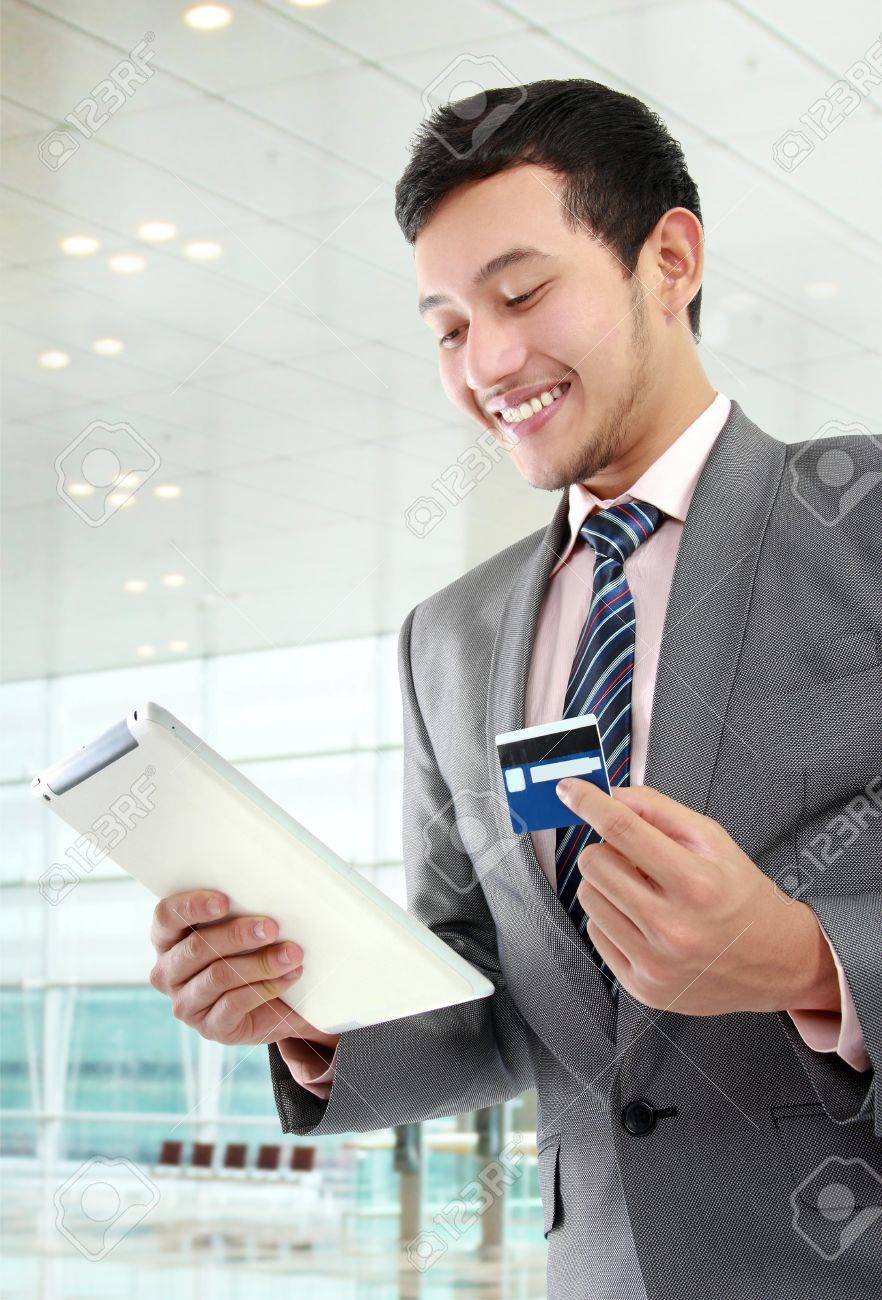 potrait of young businessman with tab and credit card doing online shopping Stock Photo - 16244933